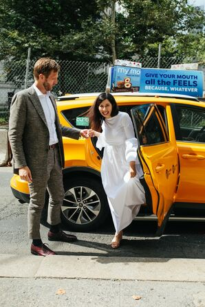 Casual Couple with Gray Suit, Modern Wedding Dress and New City York Taxi
