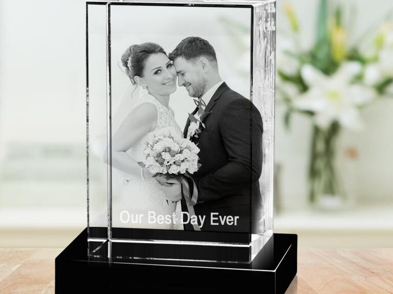 3D crystal photo block on black stand showing couple's wedding photo