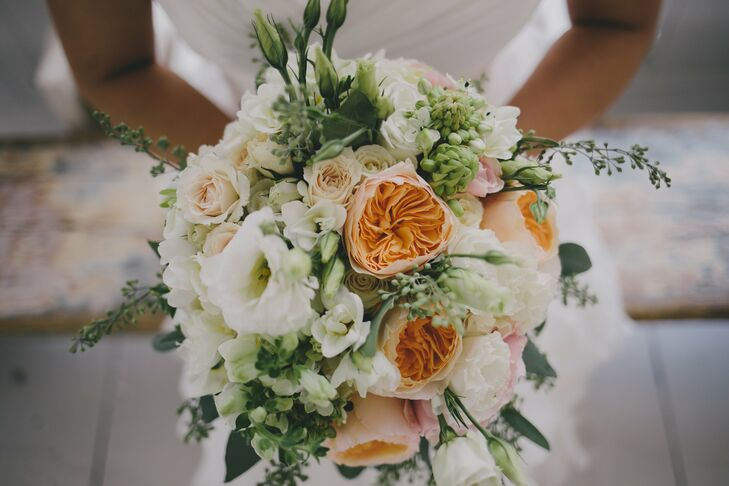 The bridal bouquet consisted warm hued roses and viburnum.
