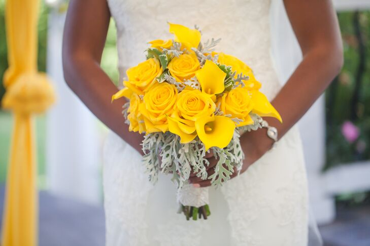 Jinitza made sure yellow (her favorite color) decorated many details, and her bridal bouquet was no different. Pink Petunia Designs arranged her bouquet filled with canary yellow roses and calla lilies, accented with dusty miller.
