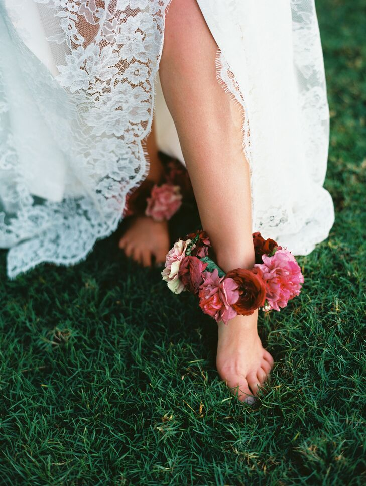 In keeping with Hawaiian traditions, Laura donned ankle lei made with deep burgundy garden roses and pink plumeria.