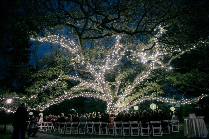 Joelle and David had an outdoor garden ceremony under a big tree decorated in fairy lights and strung with lanterns. The effect was magical.