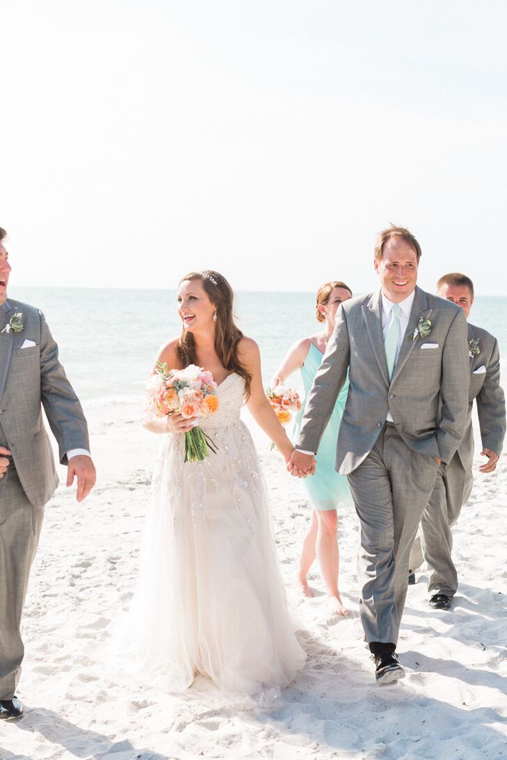 "Dallas and his groomsmen matched to a T with light gray tuxedos from Men's Wearhouse. For some color, they added mint ties to match the bridesmaid dresses and natural succulent boutonnieres wrapped in white ribbon. Their white shirts, however, had a personalized accent. ""Dallas bought each of the groomsmen, ushers and dads custom cuff links from England,"" Stephanie says. ""One cuff link had a map of where the guy was from and the other had a map of Naples, Florida."""