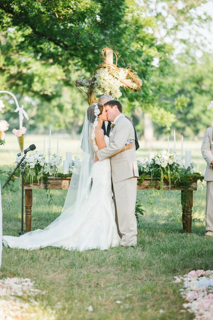 Kayla and Owen balanced out their rustic working-ranch venue with elegant vintage details and a soft color scheme of green, pink and cream.