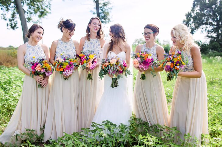 "Since much of their decor was painted in a metallic gold hue, Molly envisioned bright, colorful blooms for the day's design. Kelly Heyboer, co-owner of Wildwood Family Farms, designed the floral arrangements based on one of Molly's Pinterest boards. ""She executed it better than I imagined,"" Molly says. As for the bridesmaids, each rocked an embellished ASOS maxi dress that Molly describes as ""a little bohemian and a lot glamorous."""