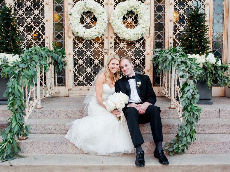 wedding couple sitting on church steps