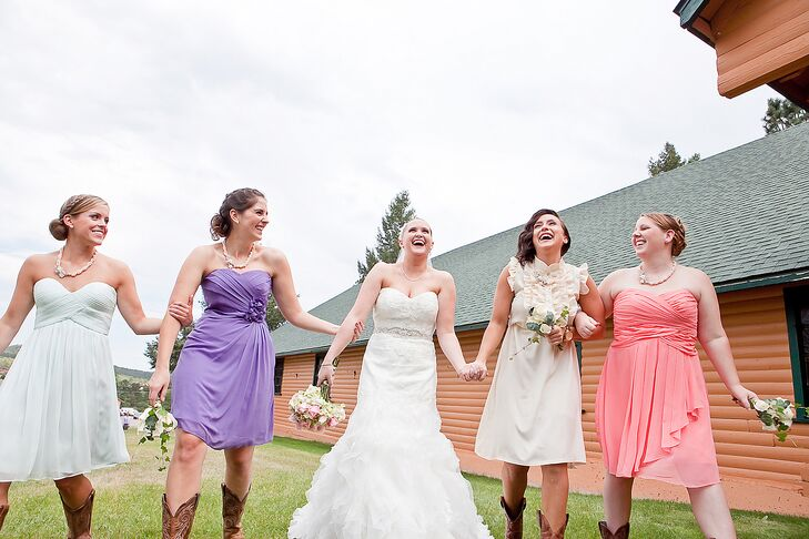 The bridesmaids wore whatever dresses they wanted as long as they were cocktail length. Everyone wore cowboy boots for a little rustic fair.