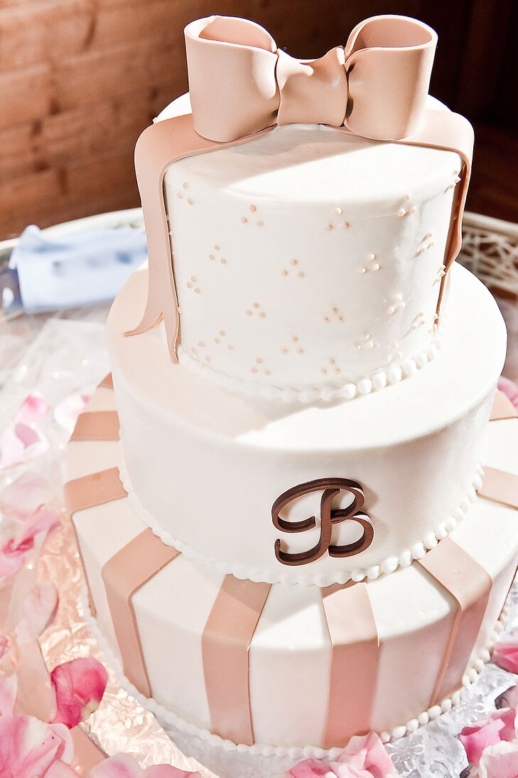 """""""Our cake was my dream come true,"""" Kirsten says. """"I love bows and girly details and it was spot on. And the cake itself was spectacular."""""""