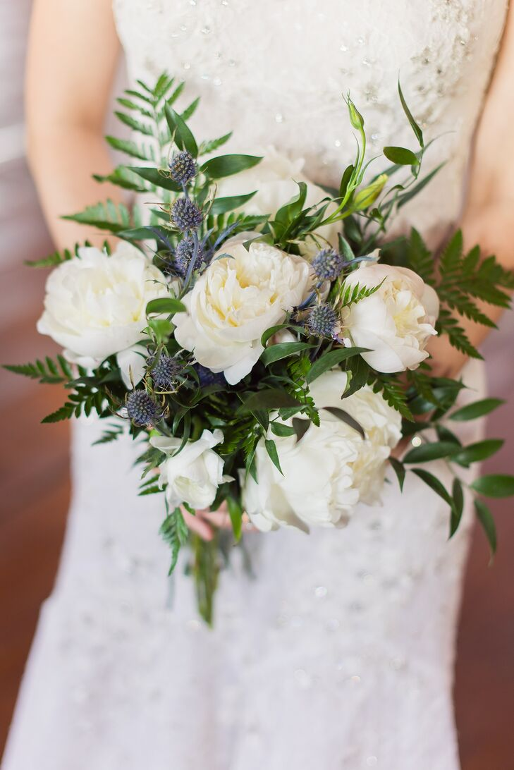 """""""I was drawn to peonies, garden roses, ferns and anything simple and romantic,"""" Jo says of her lush flower choices."""