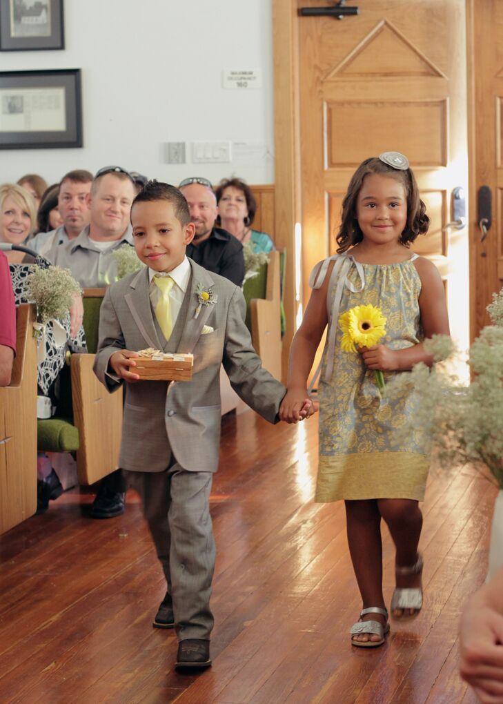 The flower girl wore a gray, white and yellow pillowcase dress from Etsy and carried yellow daisies. The ring bearer wore a gray suit and yellow tie to match the groomsmen.