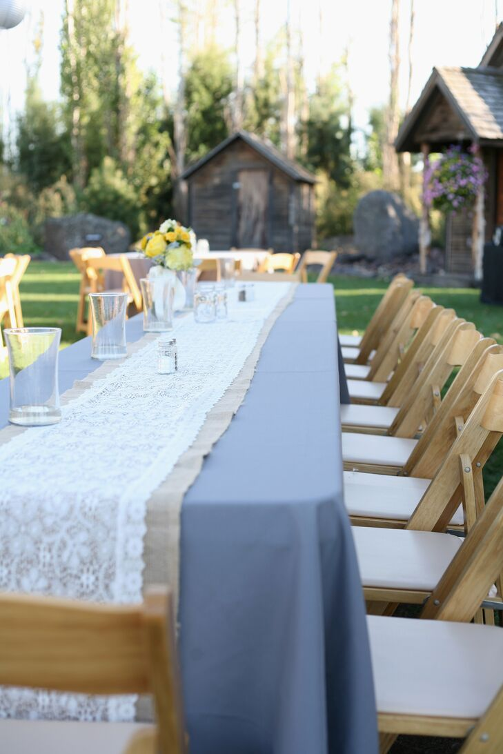 The reception tables were decorated with gray linens to match the wedding colors and accented with burlap and lace runners for a little rustic flair.