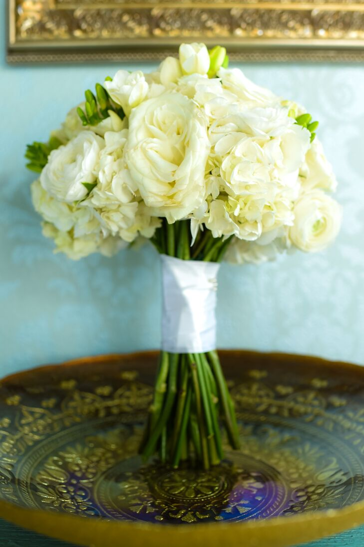 Courtney carried an ivory bouquet with roses, hydrangeas and ranunculus.