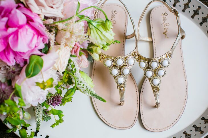 To fit the casual waterfront venue, Callie paired her dress with Lilly Pulitzer sandals. The metallic gold leather decorated with rhinestones and beading was the perfect chic, summery beach look.