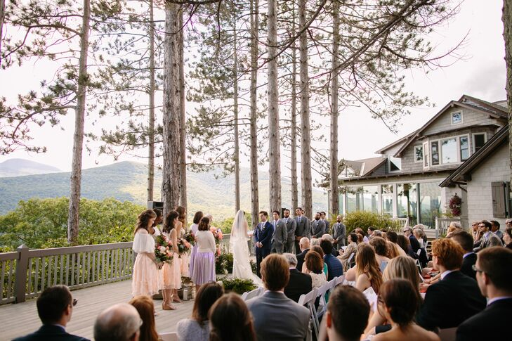 Taking advantage of Onteora's striking mountain views, Julia and Lucas gathered their friends and family outdoors for a ceremony set against tall old-growth trees and rolling hills covered in lush greenery.