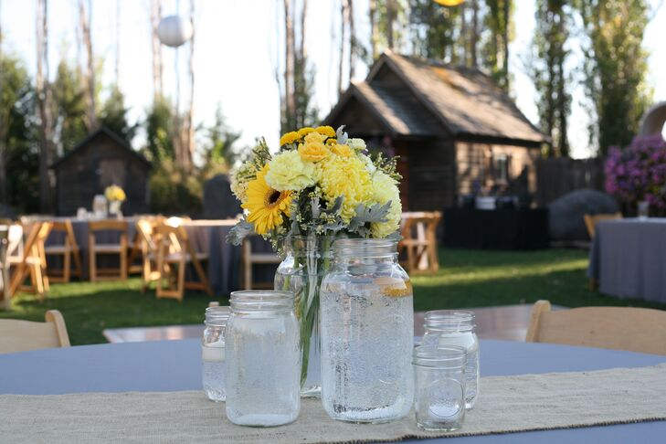 The centerpieces included yellow gerbera daisies, carnations, roses and lab's ear.
