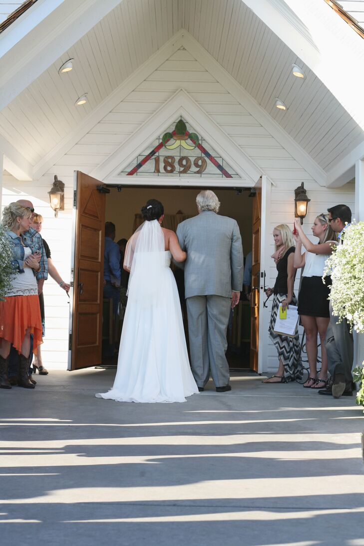 "Nicole and Derrick exchanged vows at Still Water Hollow in Nampa. ""It's a beautiful venue that sits out in the country,"" Nicole says. The little white chapel was transplanted years ago from another property."