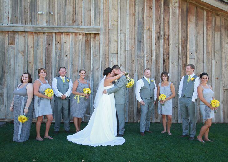 The groom and his groomsmen wore soft gray suits with white button ups. The bridesmaids wore ruffled gray dresses from Etsy.