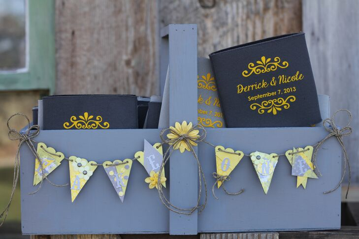 Nicole and Derrick gave guests custom gray and yellow koozies with their names and wedding date.