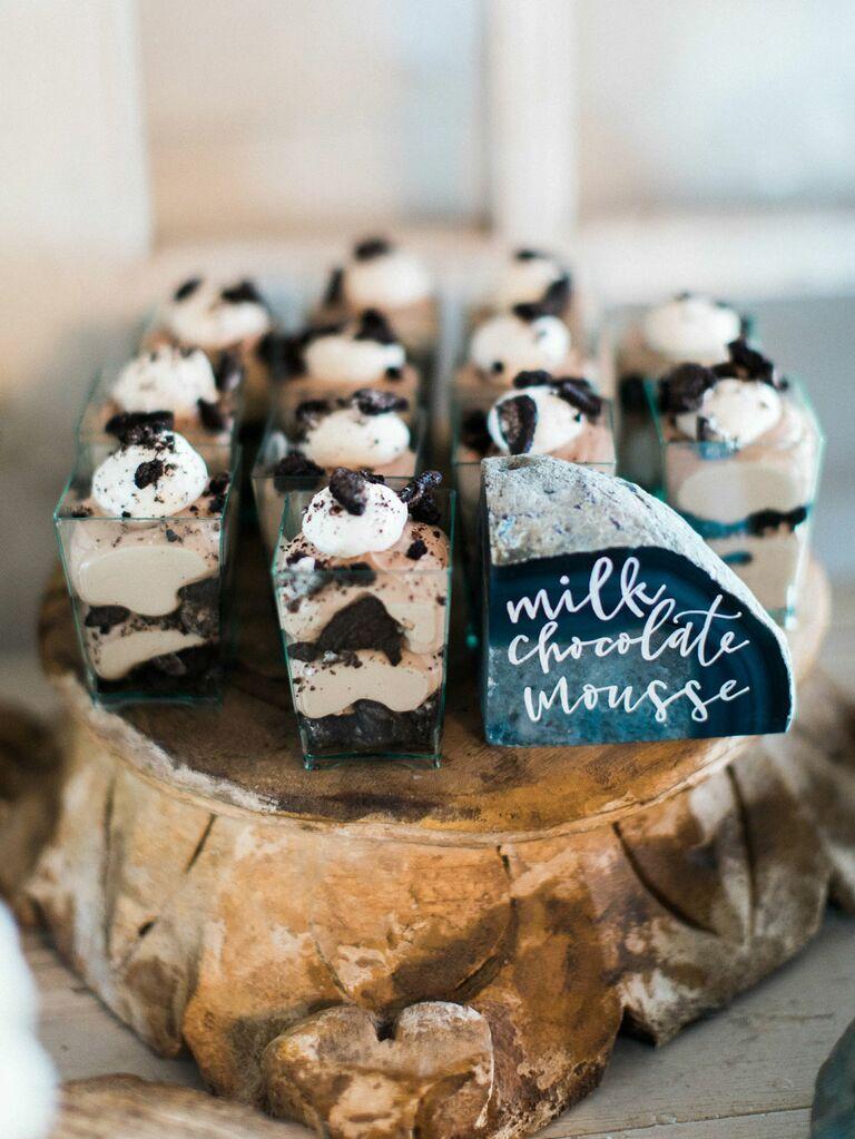 Wedding mousse dessert on rustic wood display