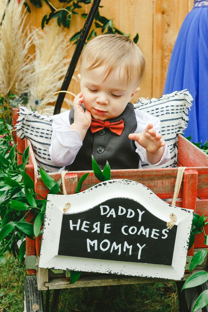 Son in Wagon with Custom Sign