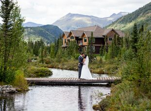Wanting a wedding vibe that combined pearls and vintage lace with a rustic cabin in the woods, Jenna Krohn (24 and a senior HR a