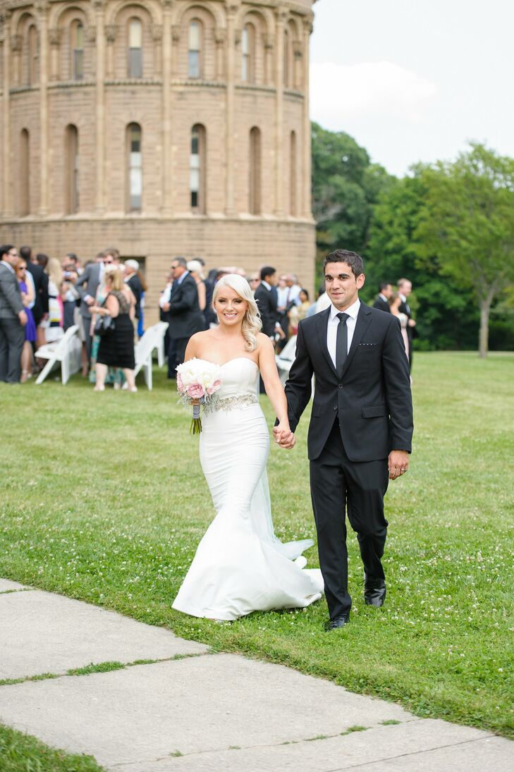 An embellished BHLDN belt added a touch of sparkle to Clare's sleek, strapless, mermaid-style Nicole Miller gown.