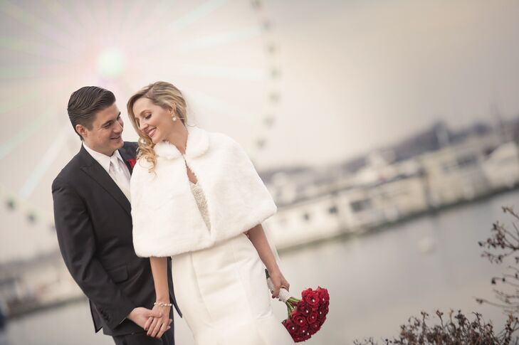 A white winter cape kept the chill off Francesca's shoulders at the couple posed for photos by the National Harbor.