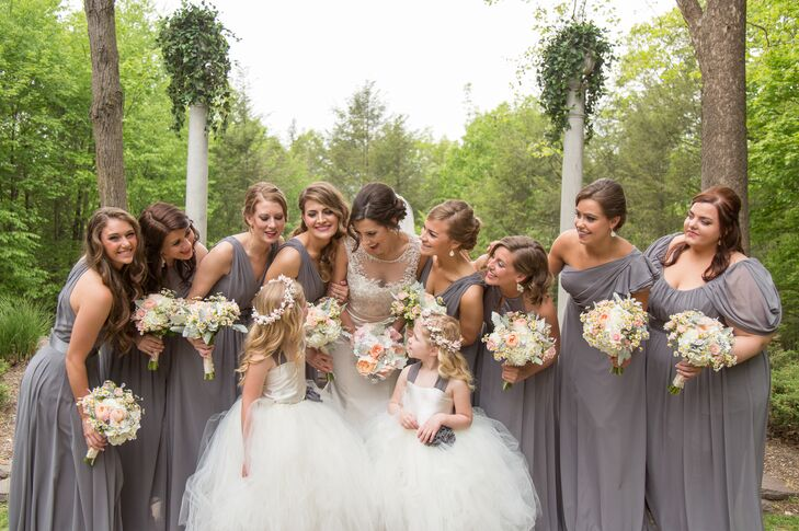 To accommodate all eight of Lindsey's bridesmaids, she found Tunis Bridal Shop, which had enough charcoal chiffon fabric to create individual styles for her group. Her three sisters wore the same style with a silk belt.