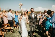 Jess Daniel and Donny Hart invited guests to their new home in Lake Leelanau, Michigan, for a casual  backyard wedding. A colorful invitation suite wi