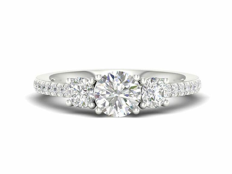 Jenny Packham engagement ring with three stone diamond setting in diamond band