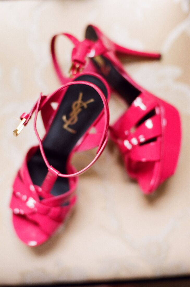 Hot pink, strappy YSL sandals added a pop of color to the bride's gown.