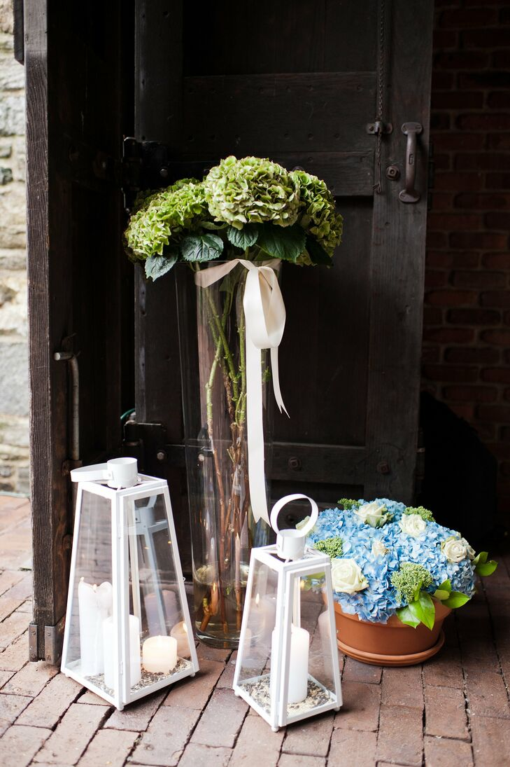 White lanterns and tall arrangements of greens and flowers decorated the day.