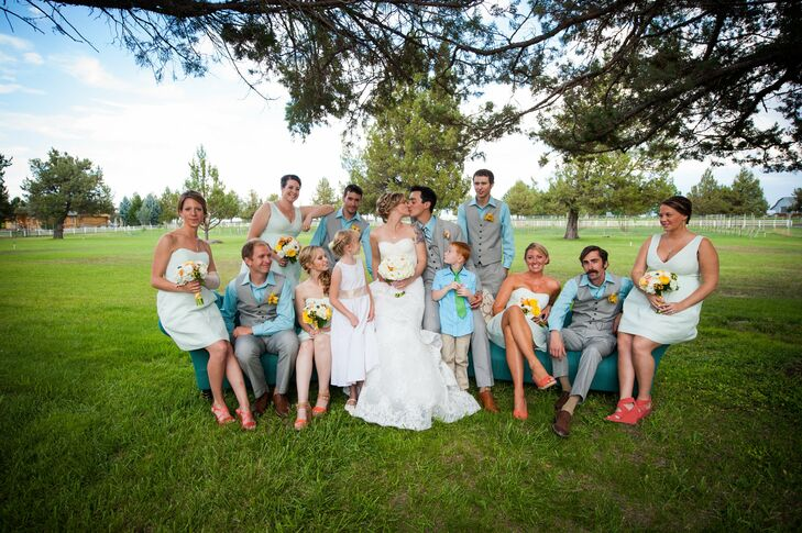 Nicole's bridesmaids wore pale green, striped dresses from J. Crew with coral heels while groomsmen wore bright, pastel blue shirts with grey vests and slacks from INC at Macy's.