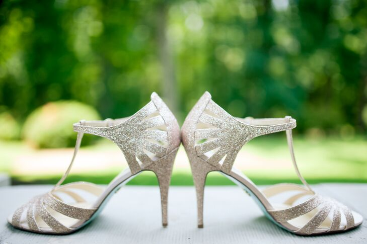 Sicilia wore a sparkling pair of open-toe gold heels that wrapped around the ankles, adding a glamorous touch to Sicilia's classic white wedding day look at large.