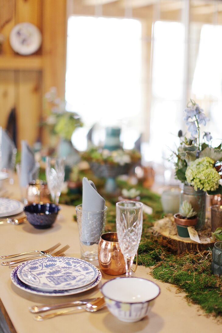 Sara and David rented the Walhonding Cabin near the treehouse for the reception. Tables were decorated with moss, wood, tree rounds, sea glass votives, succulents and floral arrangements.