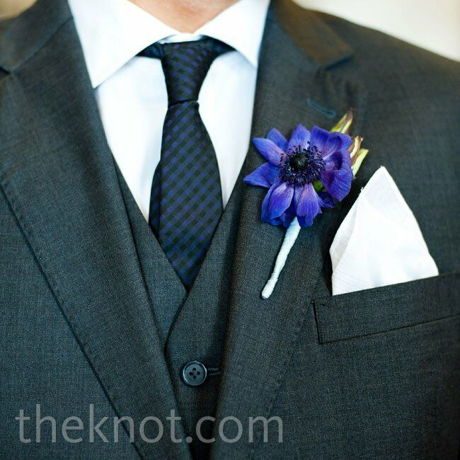 Cole's three-piece suit and patterned tie needed little extra in the way of accessorizing. A single bloom did the trick.