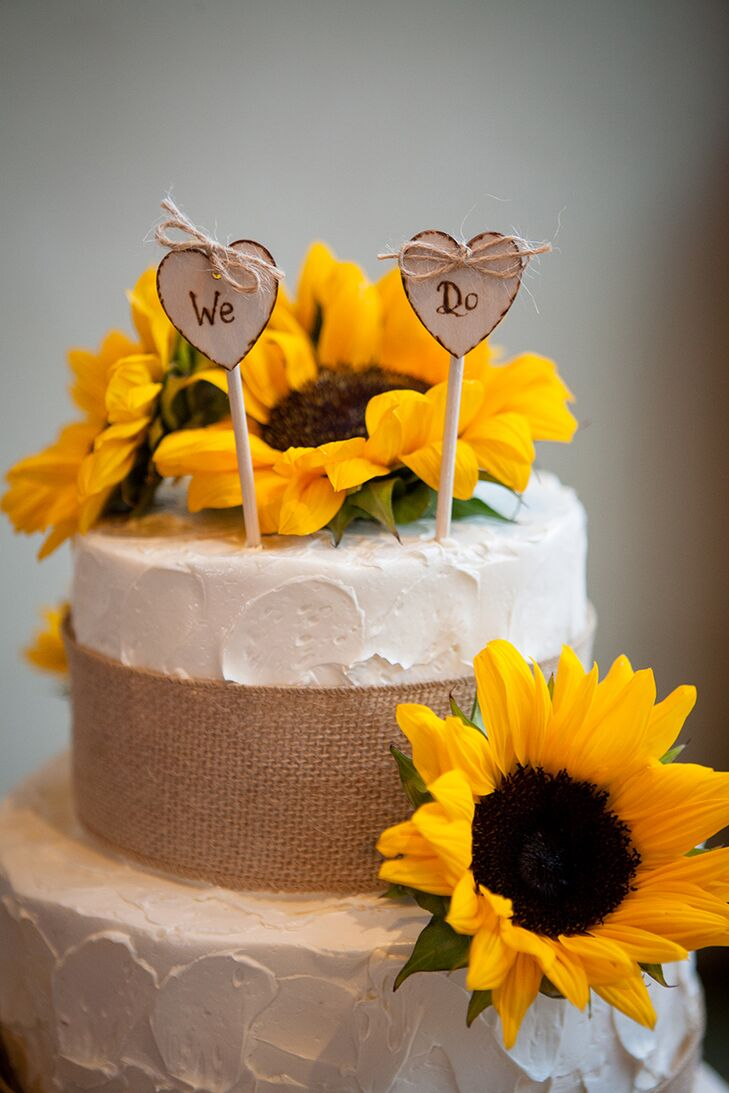 For dessert, the three tier cake, adorned with burlap and fresh decorative sunflowers, wowed guests with the vanilla chiffon with raspberry mousse and vanilla buttercream frosting.