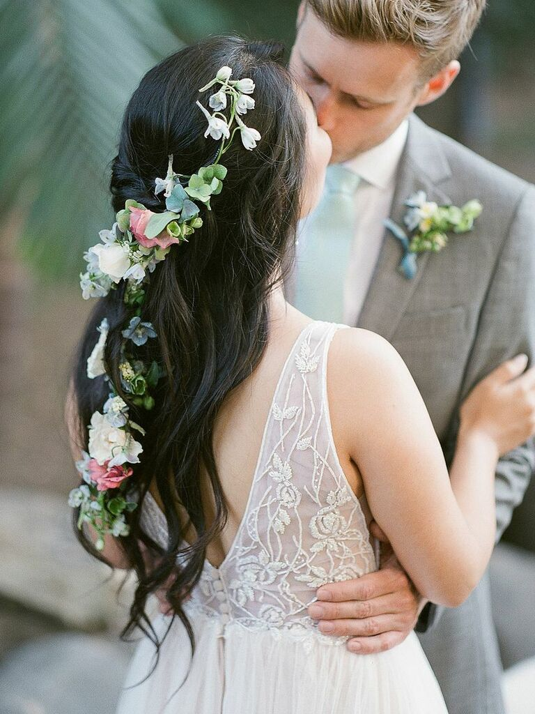 beach wedding hairstyle half up with floral hair vine
