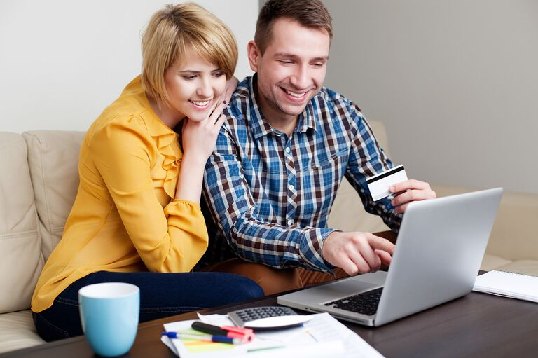 Married couple checking credit score online
