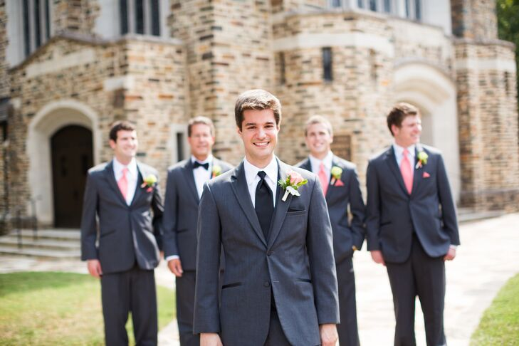 Michael and his groomsmen wore matching gray suits for the wedding. To stand out from the rest of the guys, Michael sported a black tie, while the groomsmen wore colorful coral ties with matching pocket squares.