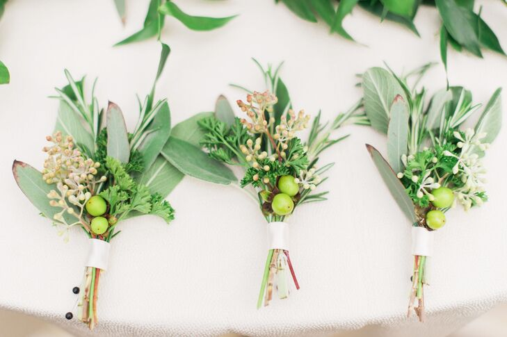 Sean's groomsmen wore garden-inspired boutonnieres made from herbs and hypericum berries and tied with a single ivory ribbon.