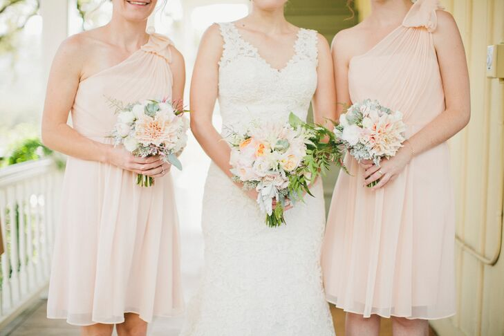 Playing off the wedding's playful peach theme, Molly chose an elegant cocktail-style dress in ethereal peach-colored chiffon for her bridesmaids to wear on the wedding day. The dresses featured a one-shoulder illusion neckline finished with a bow that lent an air of romance and playfulness.