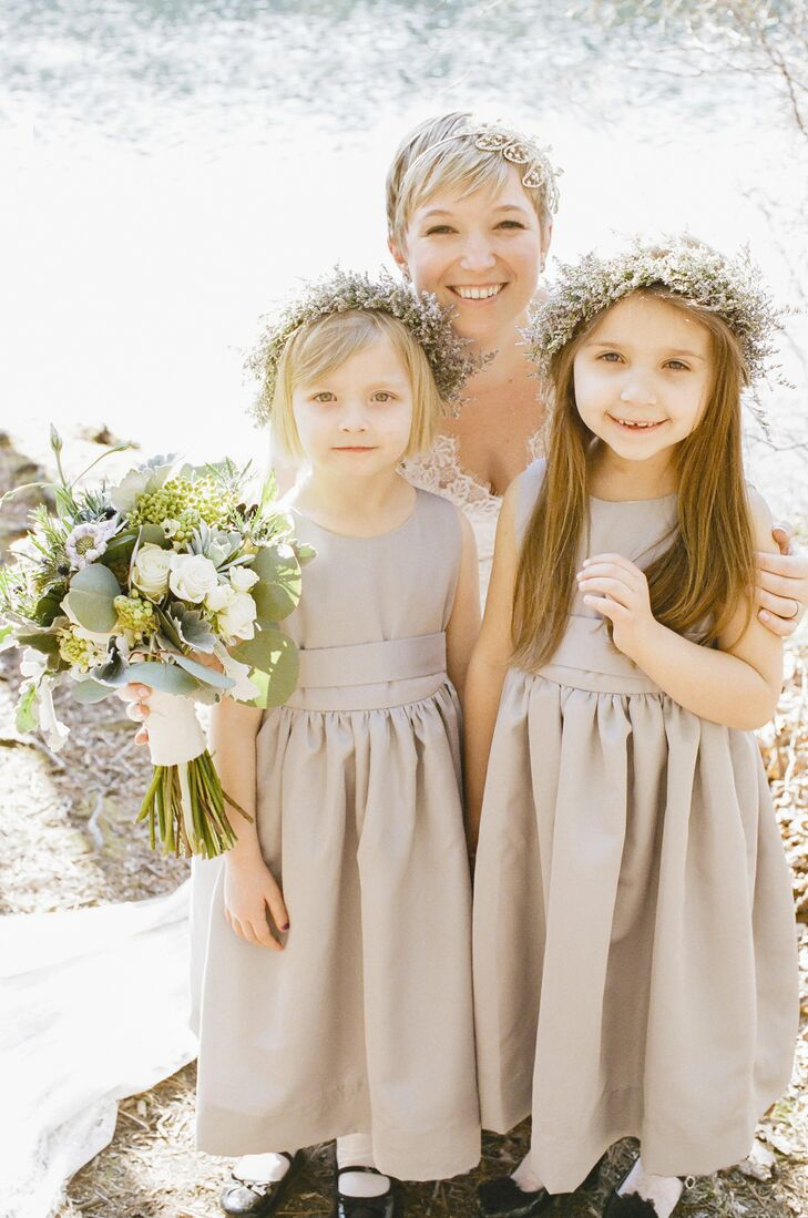 The flower girls wore charming baby's breath flower crowns.