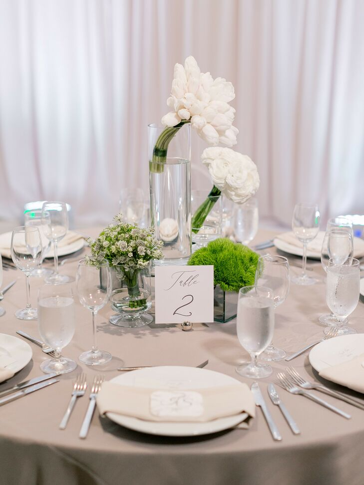 Modern White Floral Centerpieces Atop Gray Linens