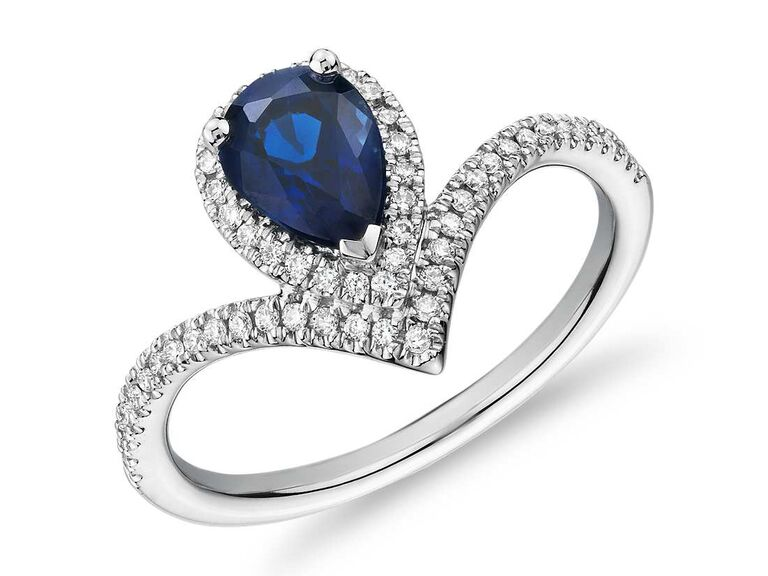 Pear-shaped sapphire engagemen ring with diamond chevron halo