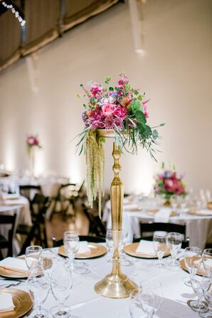 Colorful Flower Arrangements on Tall Gold Stands