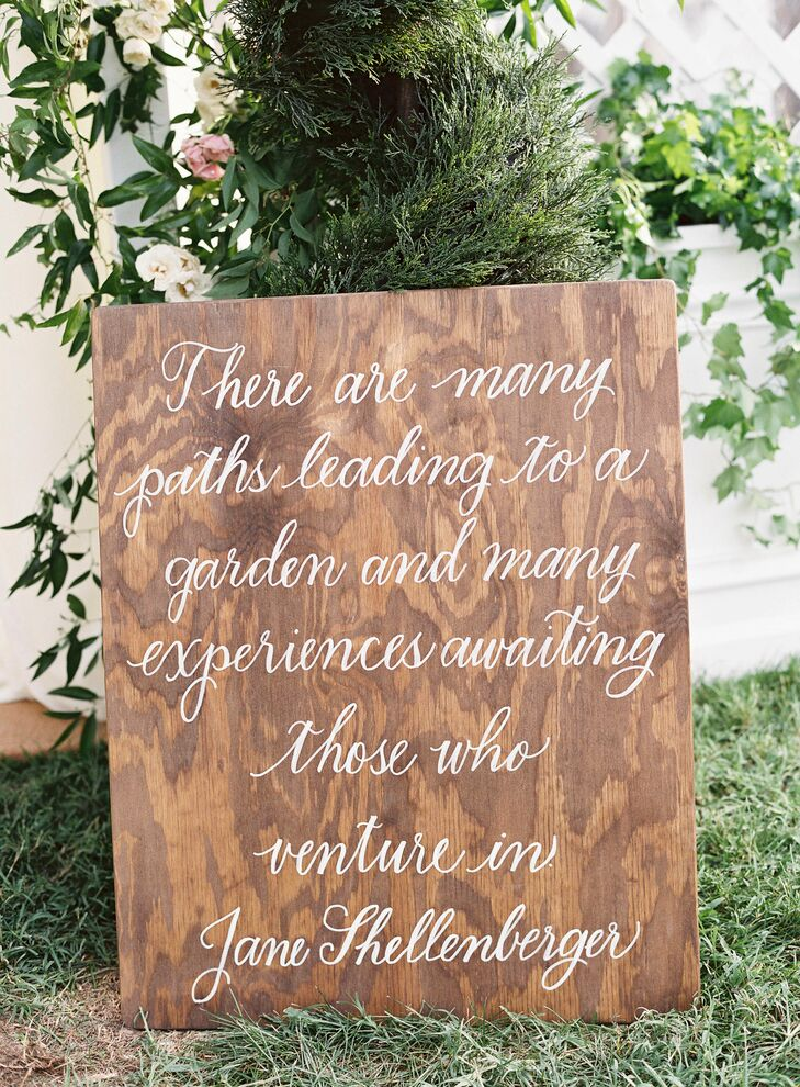 A custom wooden sign with beautiful script added a sentimental touch.