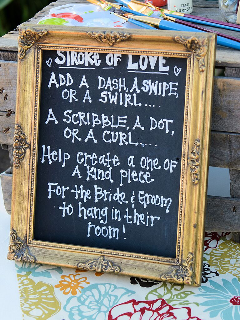 Creative wedding guestbook idea with a chalkboard sign