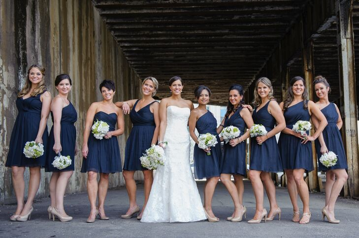 """Alison's nine bridesmaids wore J.Crew navy chiffon cocktail dresses. They had four varying necklines, and each picked her style of nude heels. """"Part of my gift to them was matching earrings, also from J.Crew, to wear on the wedding day,"""" Alison says."""