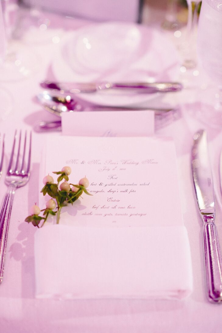 Clean and simple white menu cards were accented by fresh sprigs of berries.